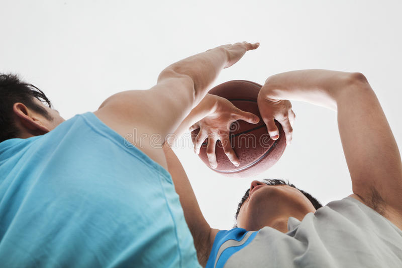 Two people playing basketball, blocking royalty free stock images