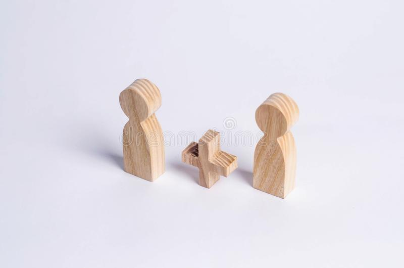 Two people with a plus in between. Wooden figures of persons. Friends, relatives, lovers. Social mathematics. Partner. Man plus ma. N on white background. A new royalty free stock photo