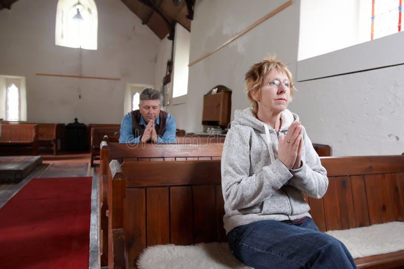 Two people praying stock image