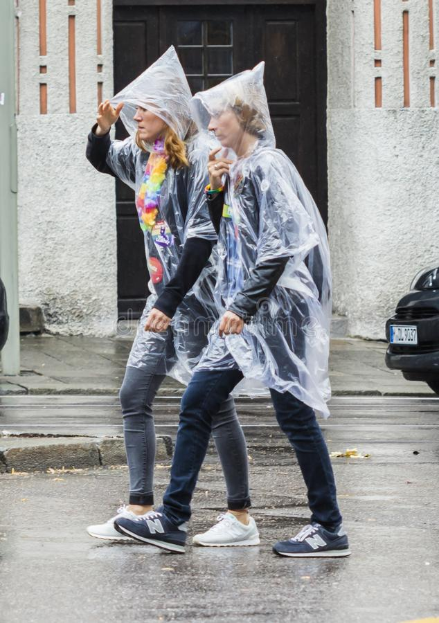 Two people in raincoats at the Christopher Street Day CSD in Munich, Germany. 2019: Two people in raincoats at the Christopher Street Day CSD in Munich, Germany royalty free stock photo