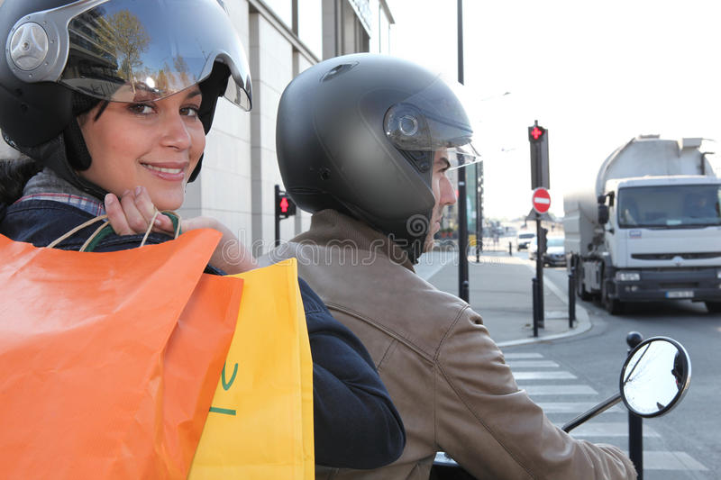 Download Two people on a scooter stock photo. Image of jacket - 24021464