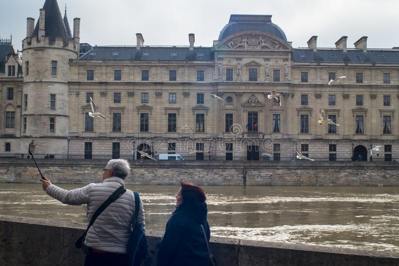 Two people taking a selfie with the flooded Seine stock photos