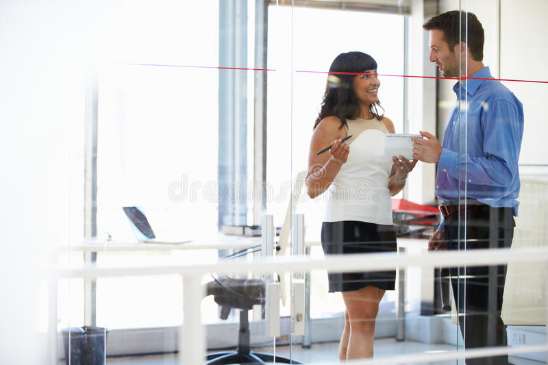 Two people talking in an office stock photography