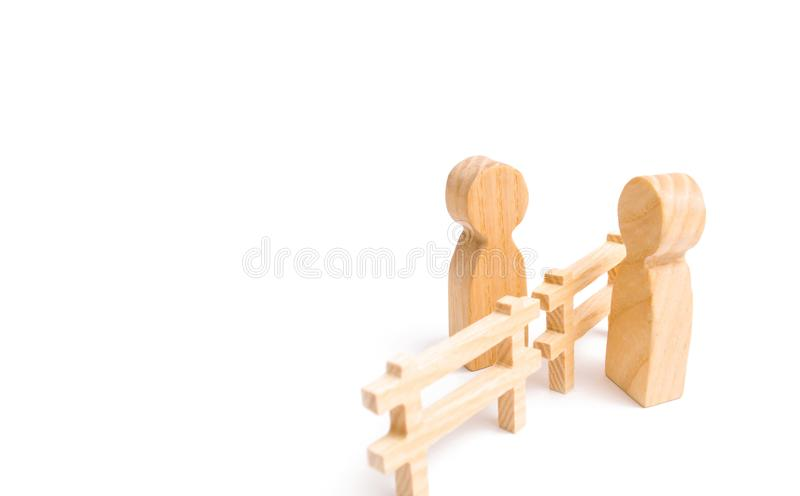 Two people are talking over the fence. People spread rumors and lies. The concept of good neighborliness, communication. And cooperation. Breaking down barriers royalty free stock photos