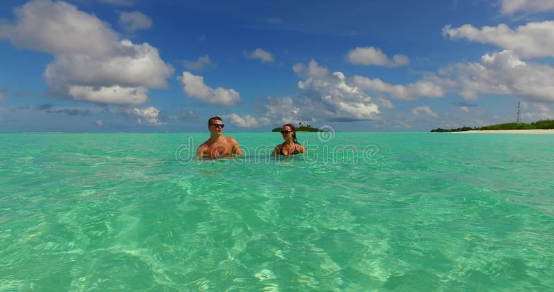 V15486 two 2 people together having fun man and woman together a romantic young couple sunbathing on a tropical island royalty free stock photos