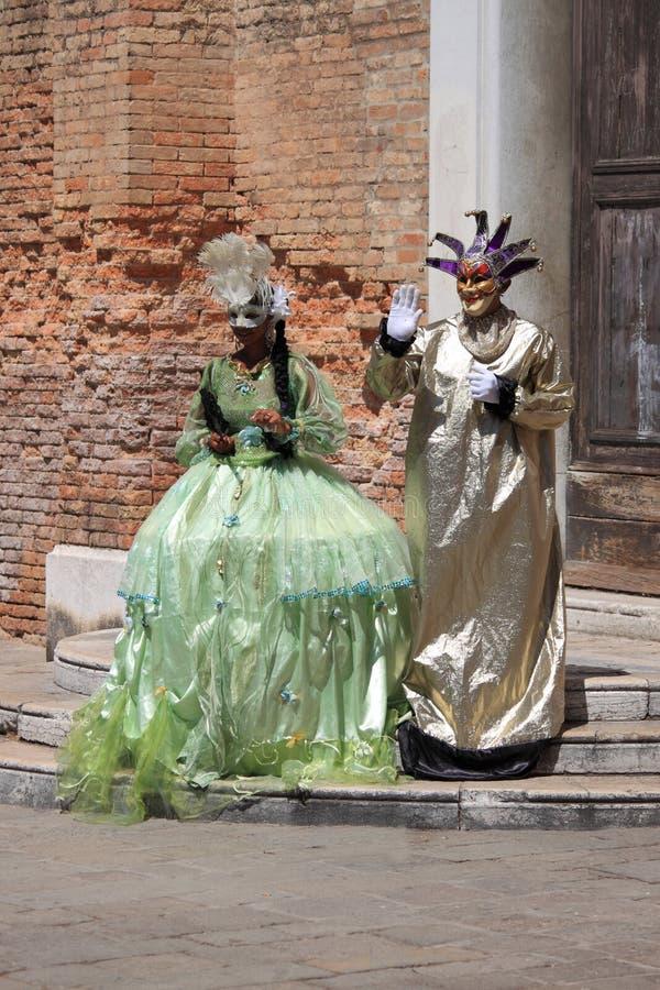 Two people in Venetian costume stock photos