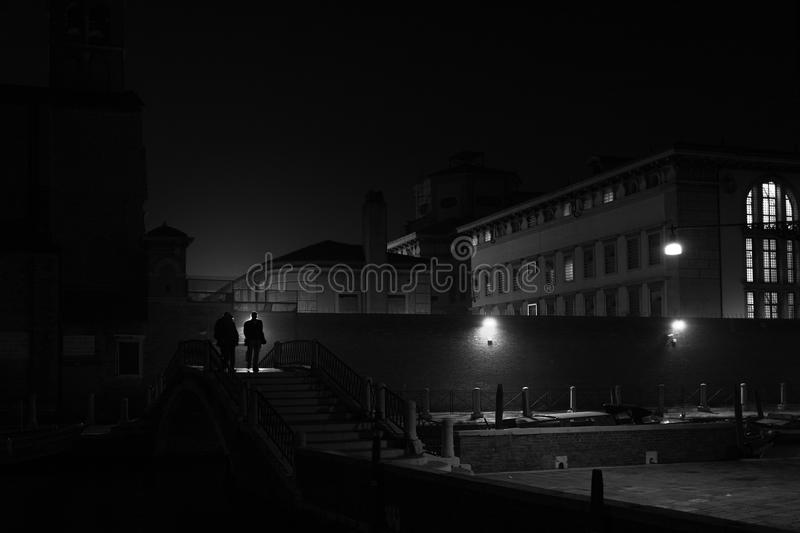 Two people in Venice at night. Two people in Venice, Italy at night stock images