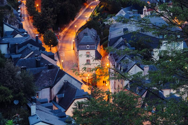 Two people are walking in  Grund Quarter in Luxembourg City during night royalty free stock photo
