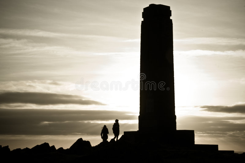 Two people walking to monument stock photos