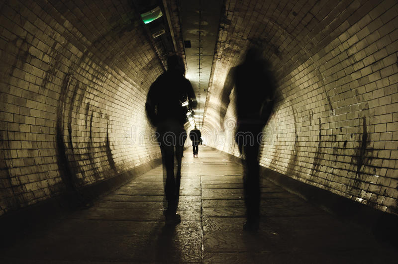 Two people walking in the tunnel royalty free stock photography