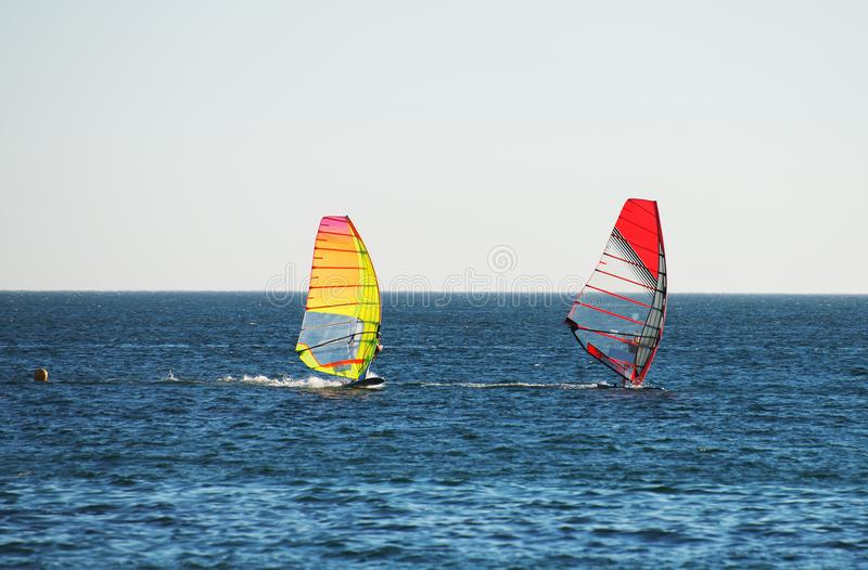 Two people windsurfing. stock images