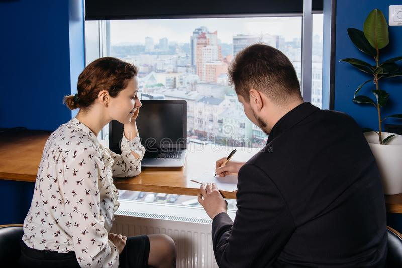 Two people working at the office. Client and manager conversation royalty free stock photo