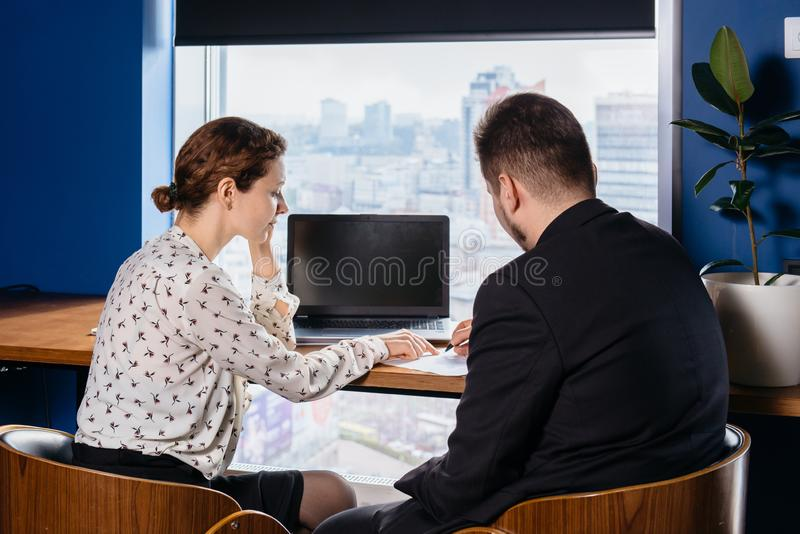 Two people working at the office. Client and manager conversation stock images