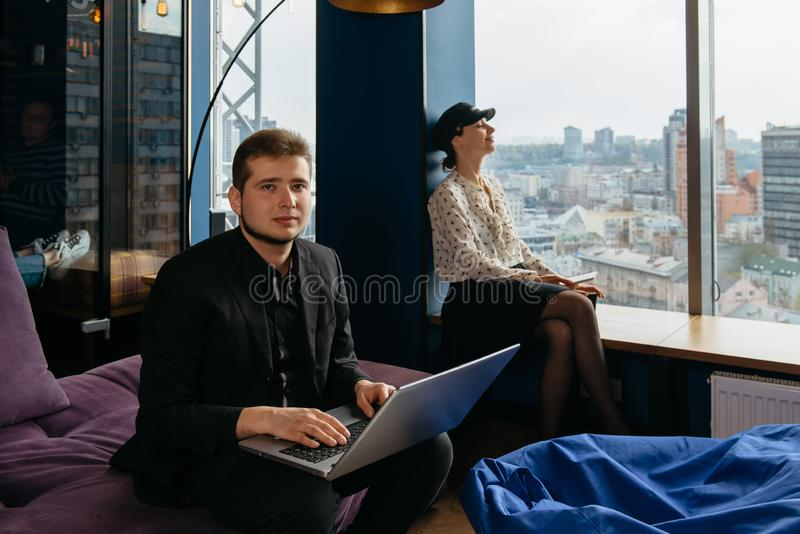 Two people working at the office or in co-working stock image