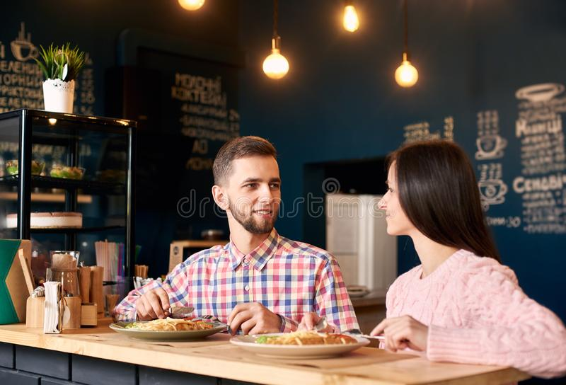 Two people young man and woman in coffee shop enjoying time spending with each other. Romantic acquaintance concept. stock image