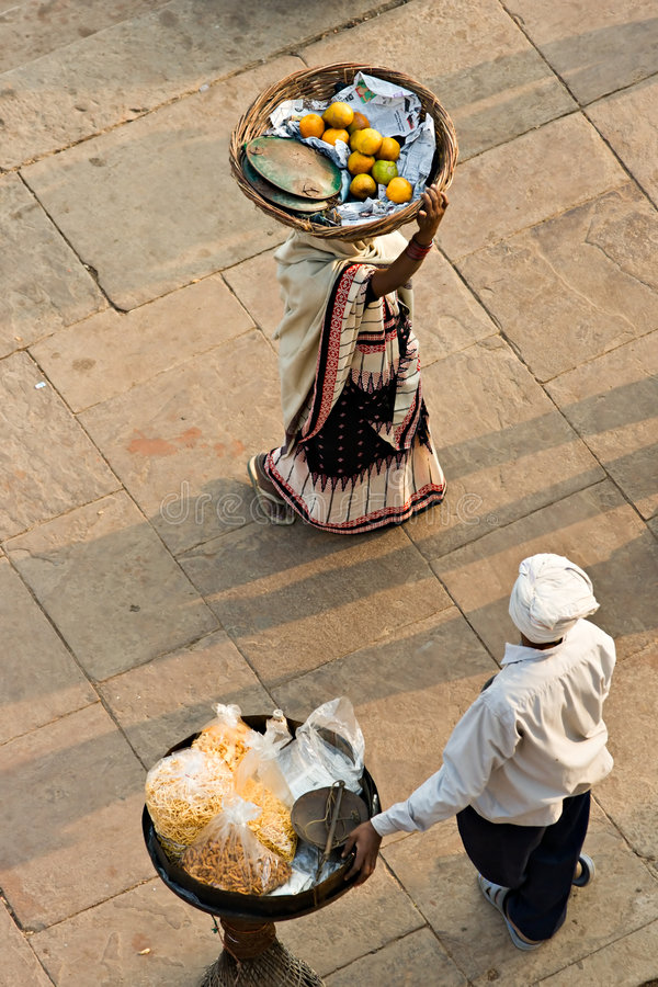 Two peoples working on the ghat, Varanasi (Benares) royalty free stock photo