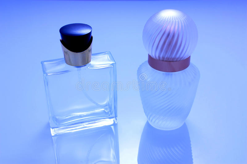 Download Two Perfume Bottles Isolated Stock Photo - Image of cosmetics, closeup: 12836322