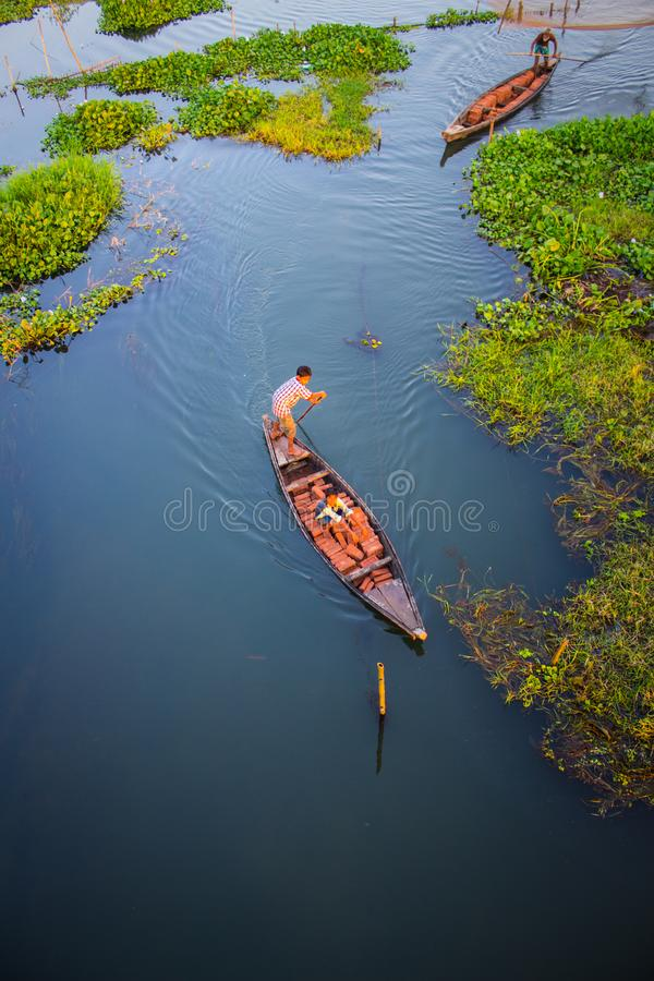Two Person Riding Black Wooden Boats stock image