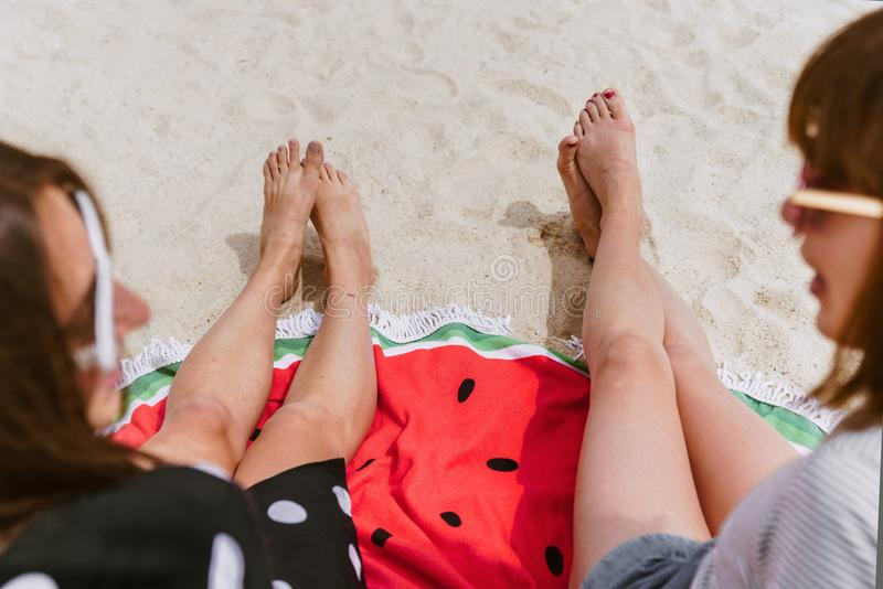 Two Person Sitting on Sand While Taking at Daytime royalty free stock image