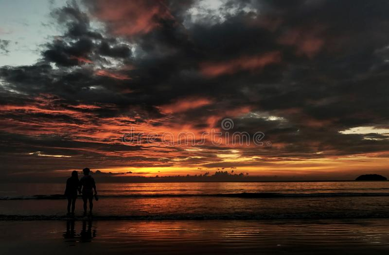 Two Person Standing on Beach Silhouette Photo royalty free stock photos
