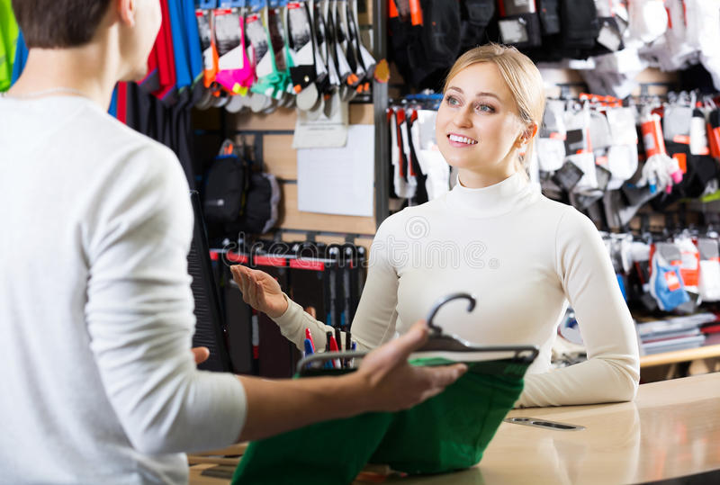 Two persons at the cashier. Portrait of two persons at the cashier in the clothing shop stock image