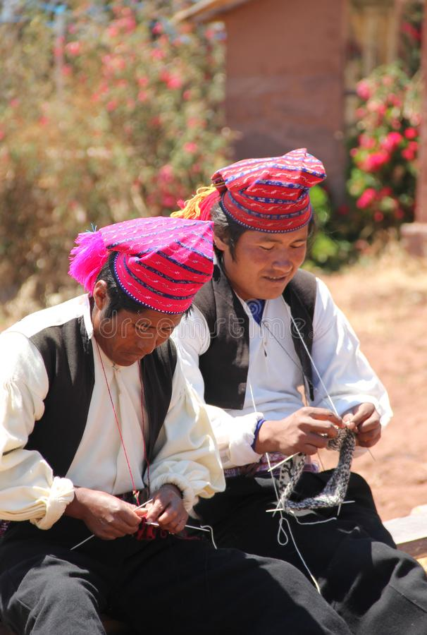 Two Peruvian man on Taquile royalty free stock photography
