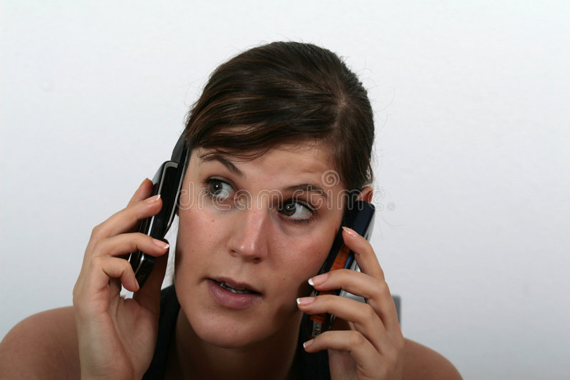 Download On Two Phones Stock Image - Image: 1719581