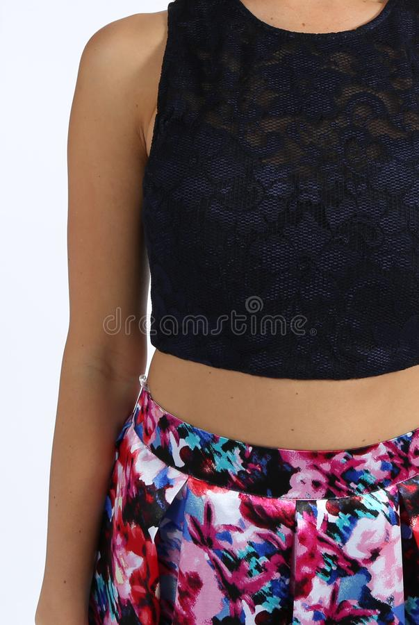 Two-Piece Sleeveless Lace Crop Top and Printed Long Skirt Dress. Two-Piece Sleeveless Lace Crop Top and Printed Short Skirt Dress... Sleeveless Halter Round Neck stock photography