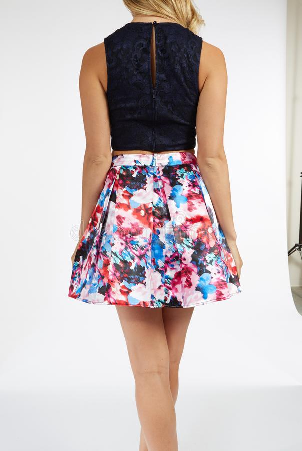 Two-Piece Sleeveless Lace Crop Top and Printed Short Skirt Dress. Sleeveless Halter Round Neck Printed Pleated Party Dress.... Sleeveless Halter Round Neck stock photo