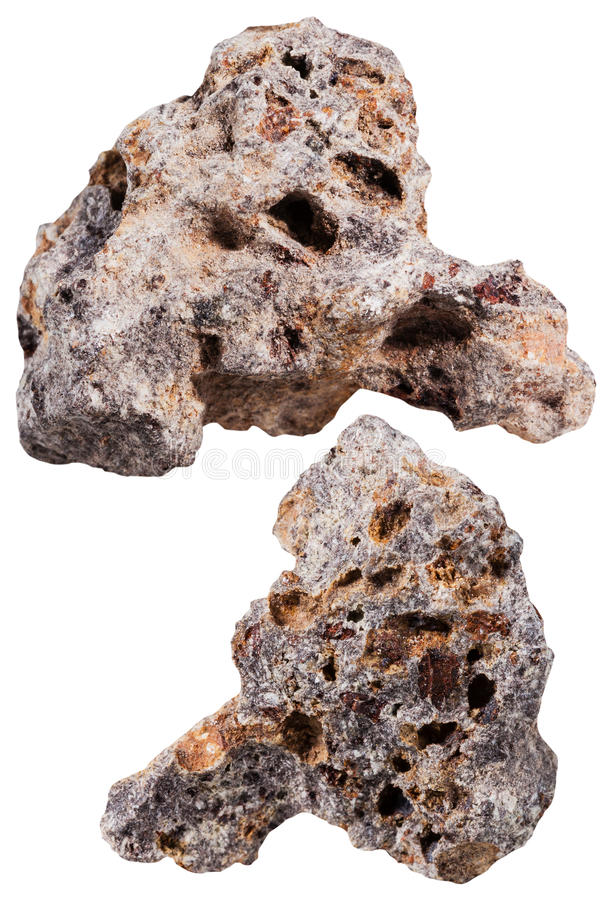 Two pieces of basalt mineral stone isolated. Macro shooting of specimen natural rock - two pieces of basalt mineral stone isolated on white background stock photo