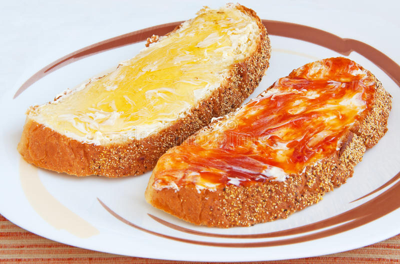 Download Two Pieces Of Bread With Butter And Jam Stock Photography - Image: 25537202