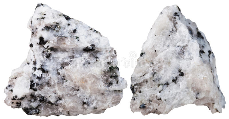 Two pieces of Diorite mineral stone isolated. Macro shooting of specimen natural rock - two pieces of Diorite mineral stone isolated on white background stock images