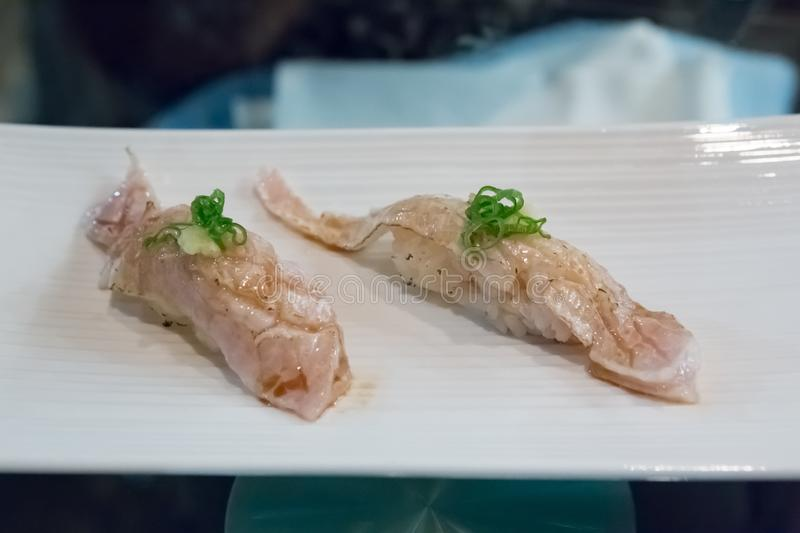 Torched Fluke Fin Sushi royalty free stock photography