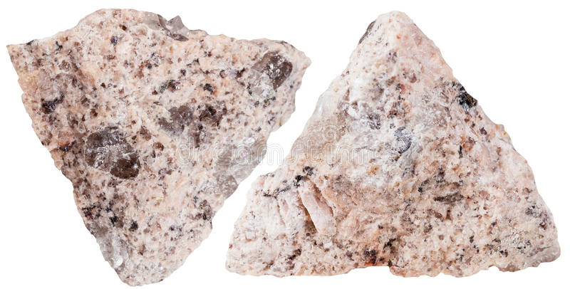 Two pieces of Granite mineral stone isolated. Macro shooting of specimen natural rock - two pieces of Granite mineral stone isolated on white background stock image