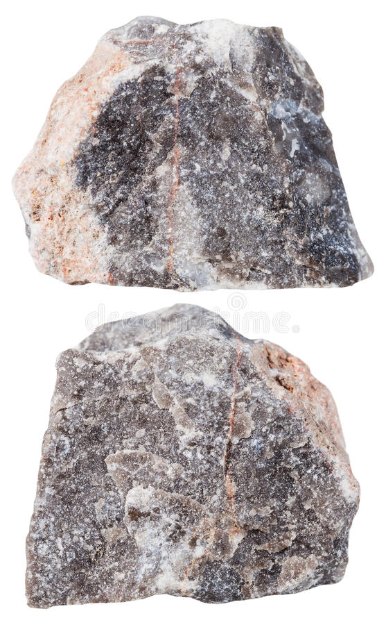 Two pieces of Limestone mineral stone isolated. Macro shooting of specimen natural rock - two pieces of Limestone mineral stone isolated on white background royalty free stock photos