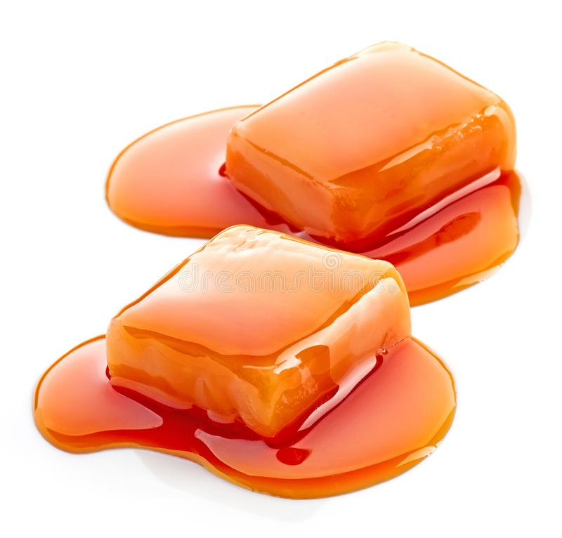 Two pieces of melted caramel candies royalty free stock photo