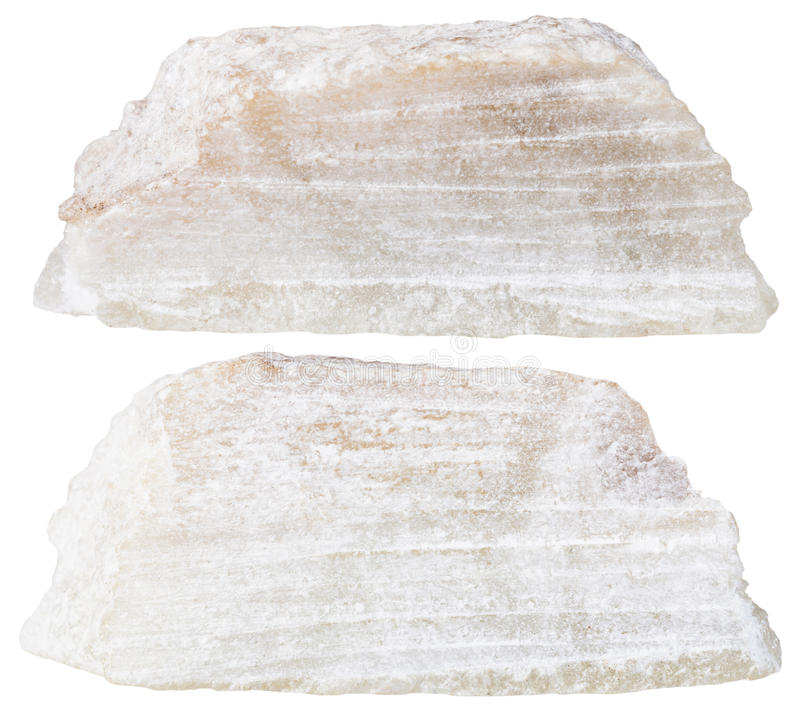 Two pieces of talc mineral stone isolated. Macro shooting of specimen natural rock - two pieces of talc mineral stone isolated on white background royalty free stock photography