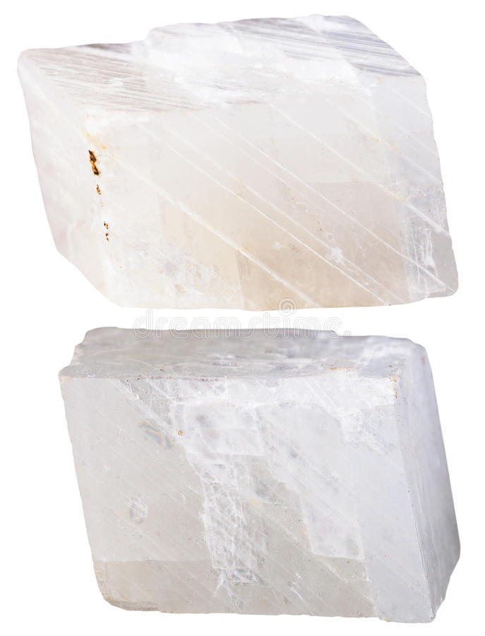 Two pieces of white calcite mineral stone. Macro shooting of specimen natural rock - two pieces of white calcite mineral stone isolated on white background royalty free stock images