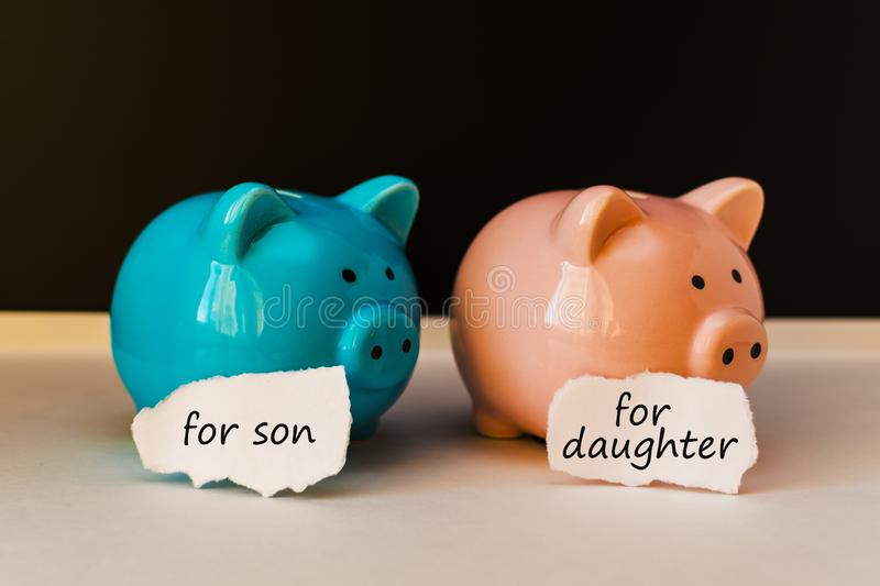 Two piggy banks with inscriptions royalty free stock photos