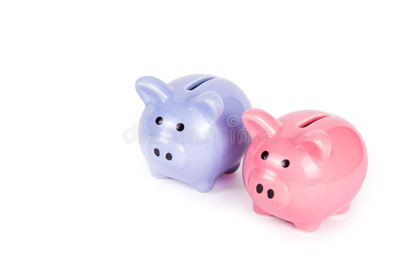 Two piggy banks on white background. Blue piggy bank on white background. Pink piggy bank. Copy space. Money and finance stock image