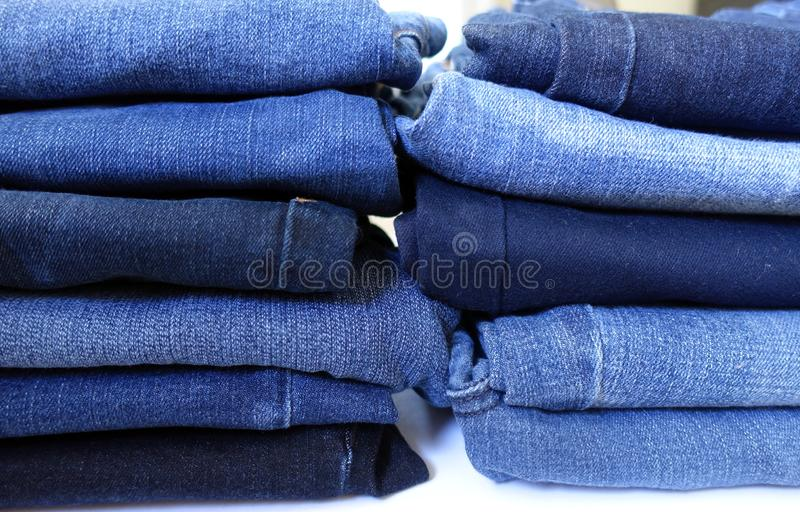 Two Piles of Denim Blue Jeans royalty free stock photo