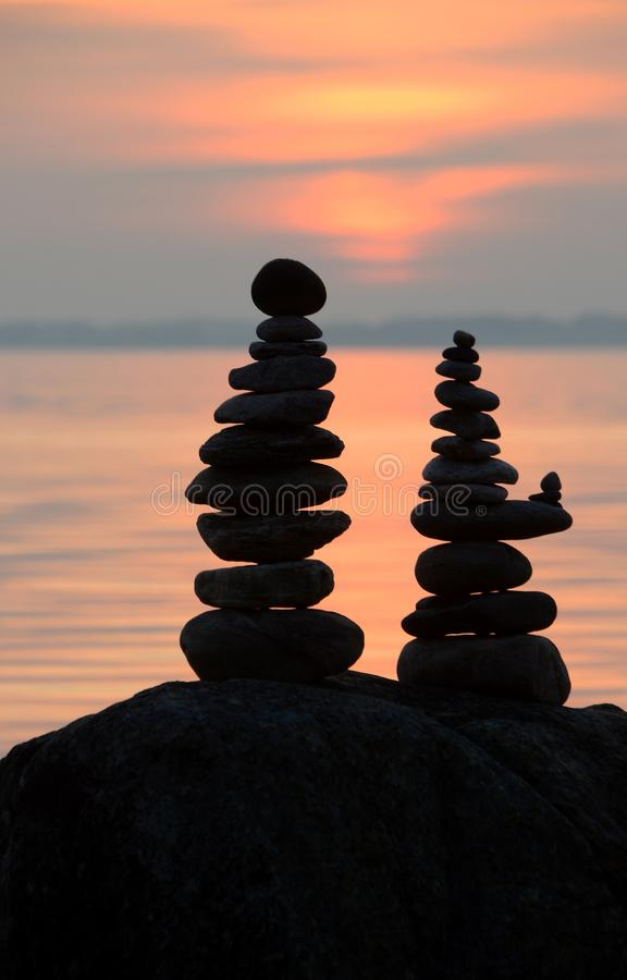 Two piles of small stones, one pile has a little addon suggesting pregnancy royalty free stock image