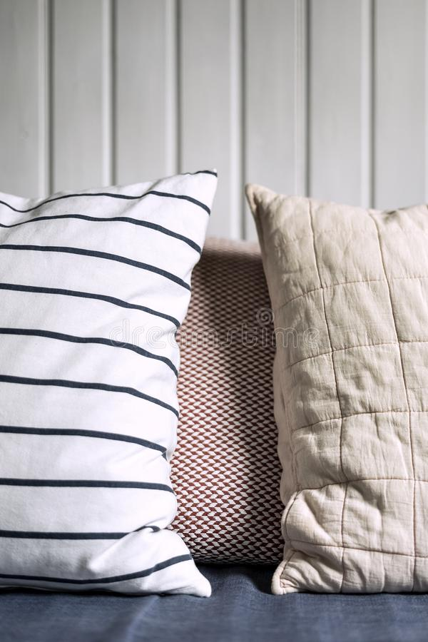 Two pillows next to each other with white background stock photos