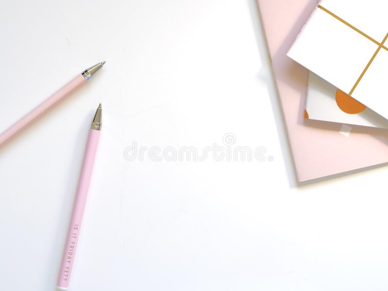 Two Pink Ballpoint Pens on Table stock images