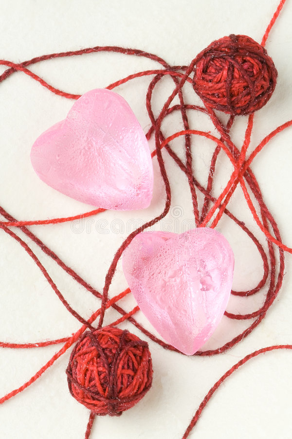 Download Two Pink Crystal Heart Shapes And Small Clew Balls Stock Photo - Image: 7581578