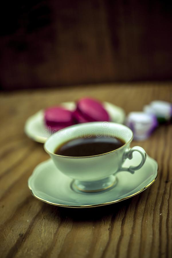 Macaroons with cup of coffee royalty free stock images