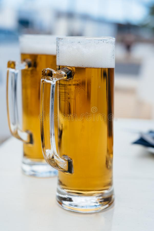 Two Pint Glasses of Cold Beer royalty free stock image
