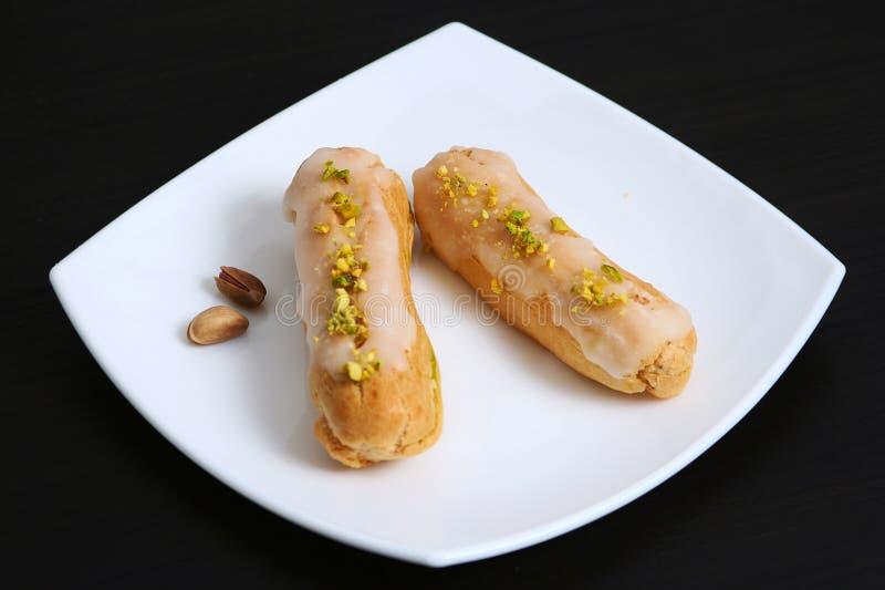 Two pistachio eclair stock photo