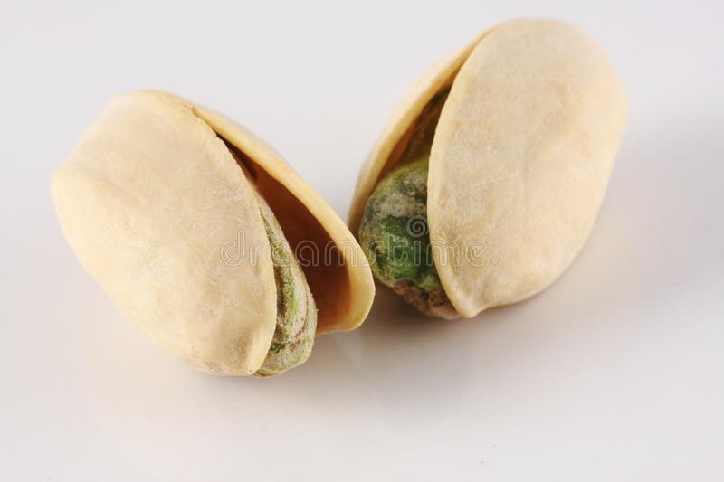 Two Pistachio nuts stock photo
