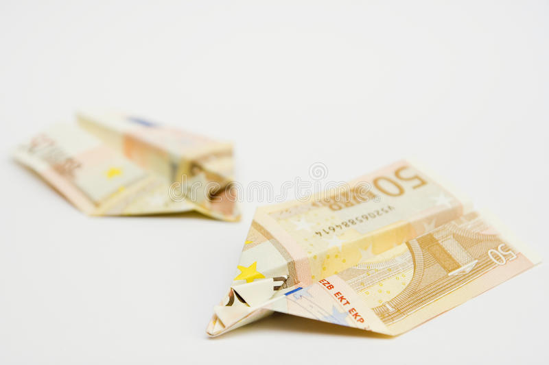 Two planes of paper money flying stock images